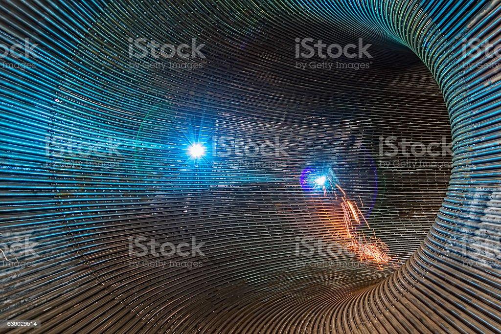 Welding metal tunnel stock photo