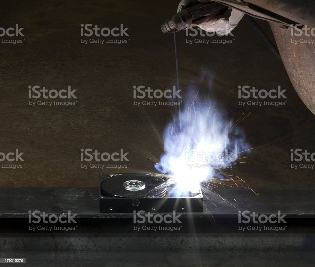 welding on a hard drive royalty-free stock photo