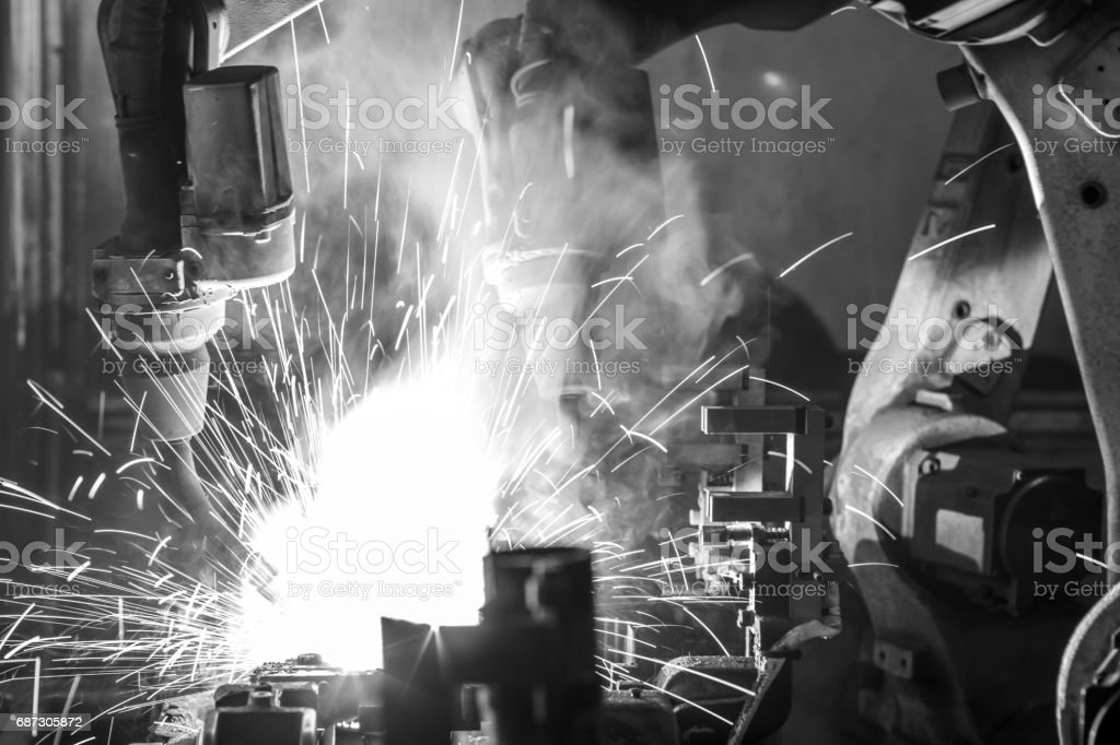 Welding robots movement in a car factory, Black&White stock photo