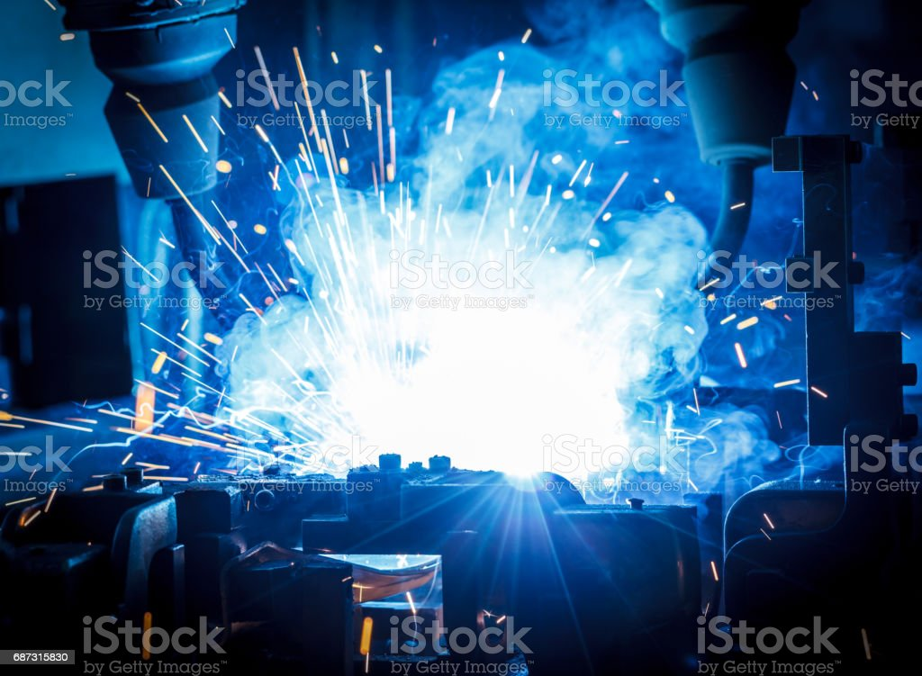 Welding robots movement in a car factory stock photo