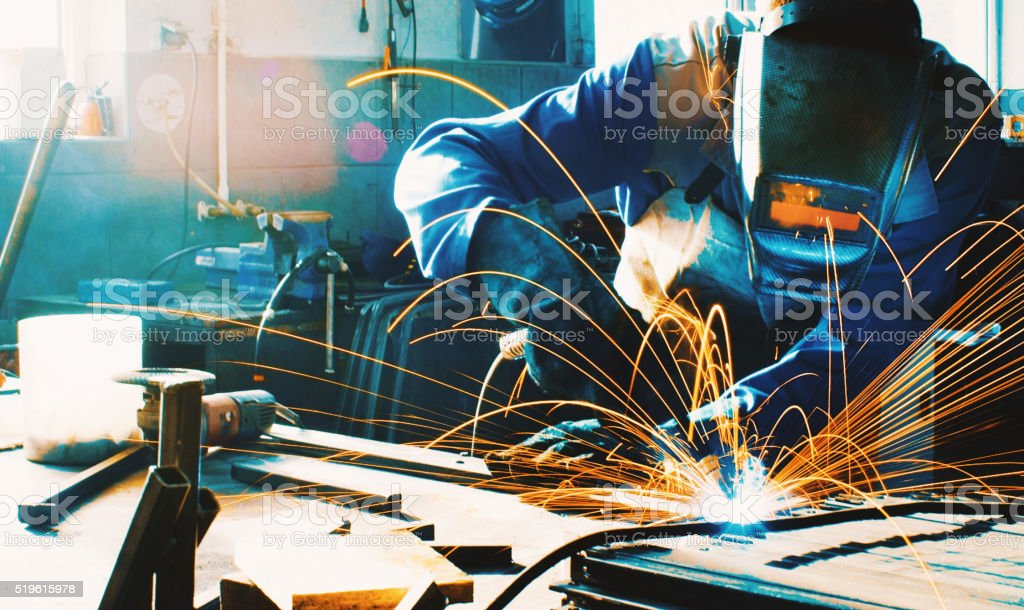 Welding two pieces of metal. stock photo