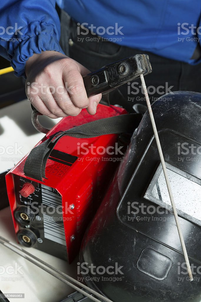 Welding unit with helmet shield royalty-free stock photo