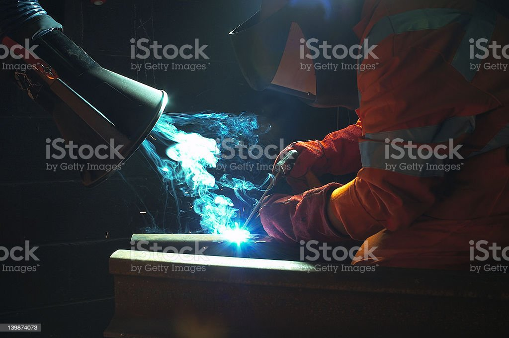 welding with extractor royalty-free stock photo