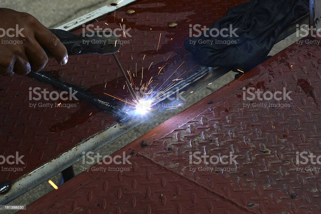 Welding with sparks stock photo