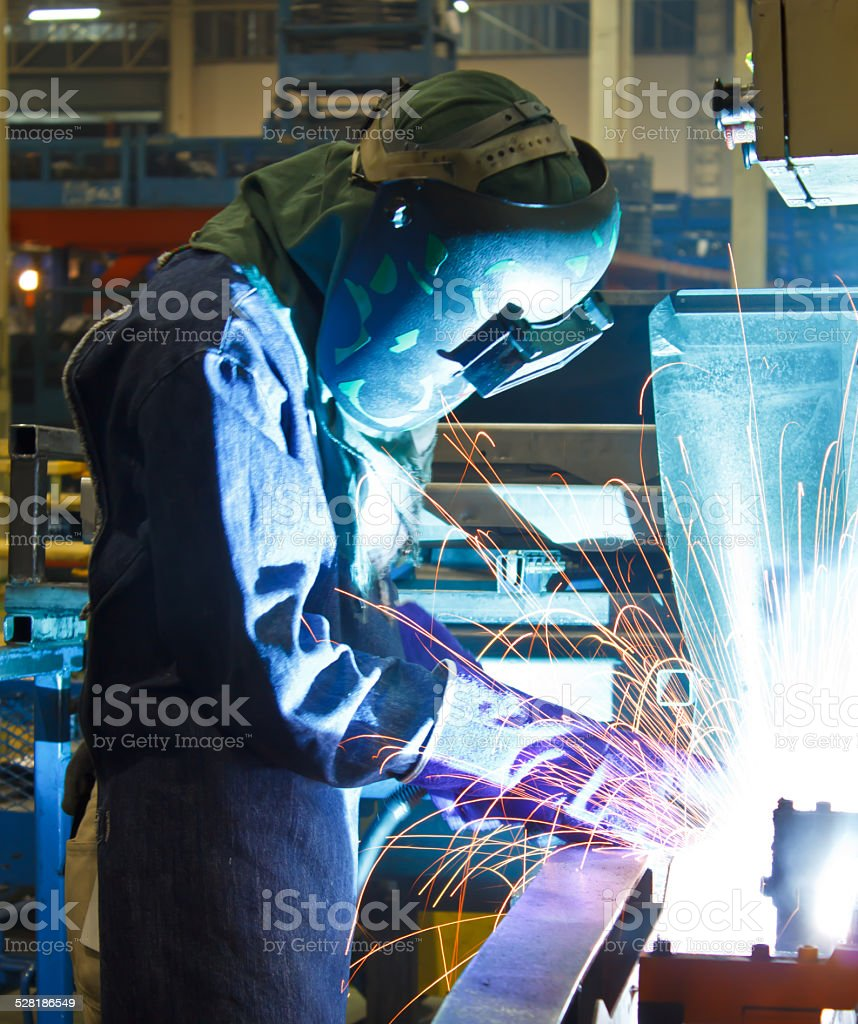 Welding with sparks the steel industry welding. stock photo