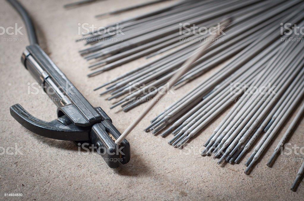 Welding with Welding rods in craftsman factory stock photo