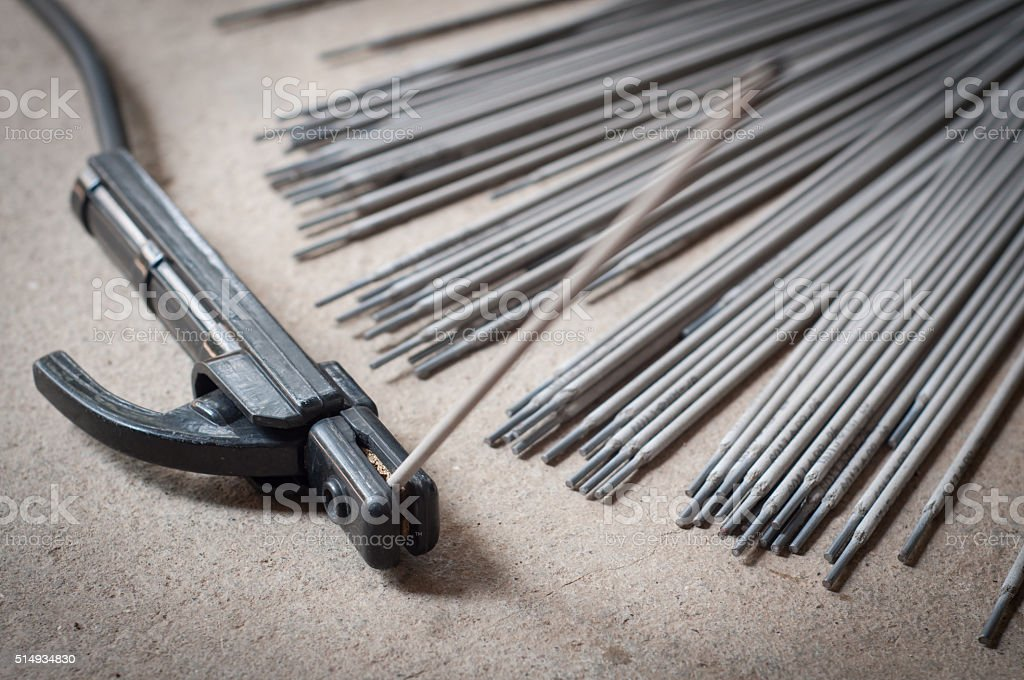 Welding with Welding rods in craftsman factory stock photo