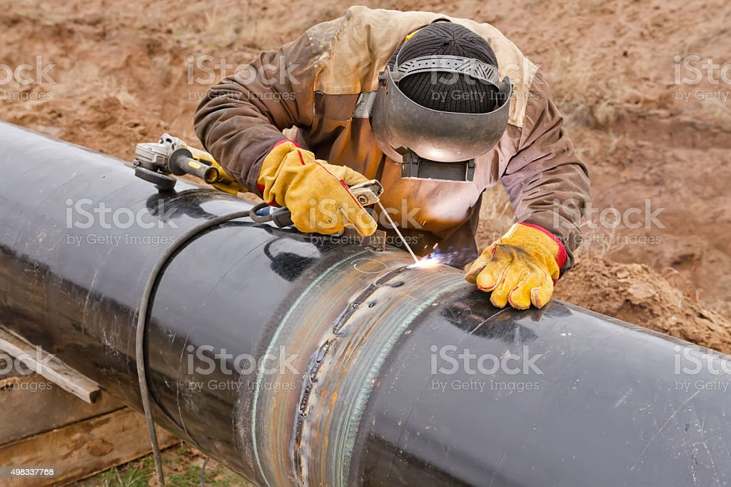 Welding works on gas pipeline stock photo