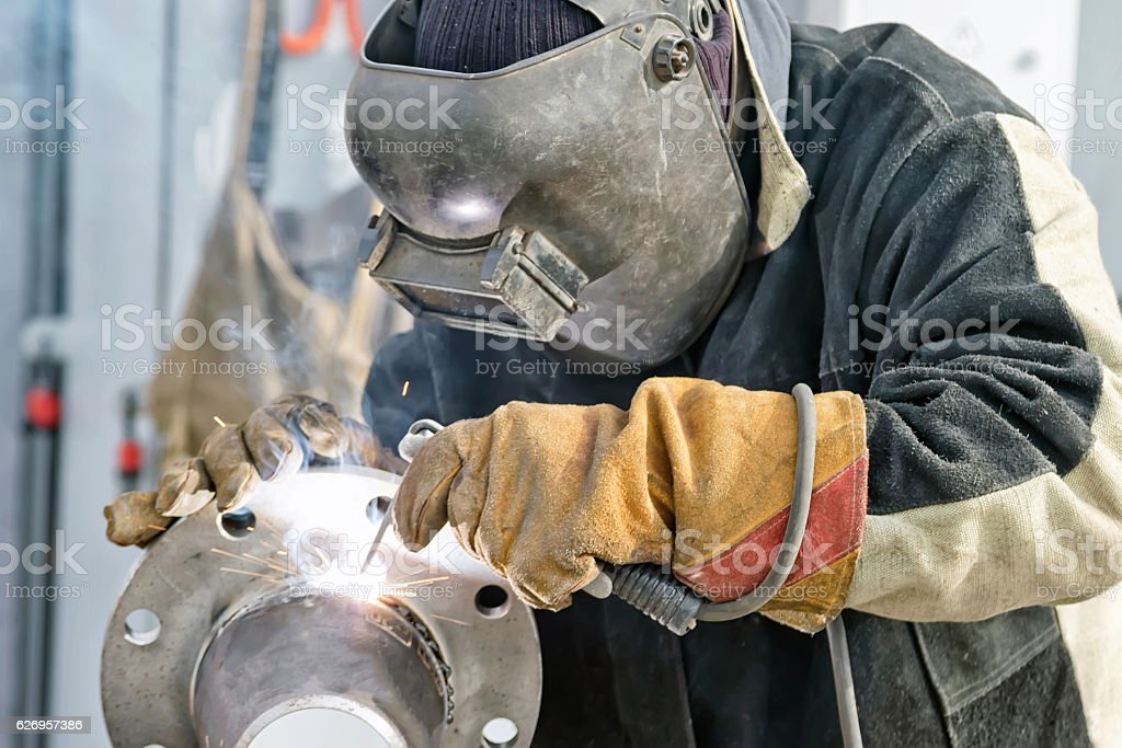 Welding works on manufacturing of units and parts of pipelines stock photo