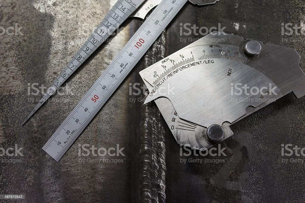 Weldment inspection by welding gage stock photo