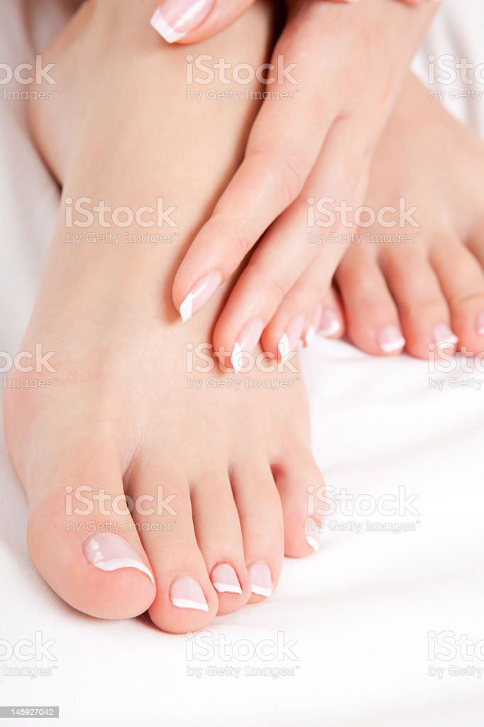 Well cared woman's feet and hands stock photo