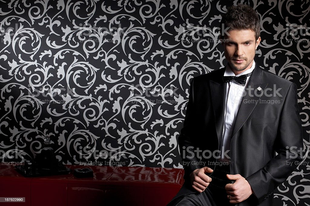 Well dressed businessman modeling men's fashion line stock photo