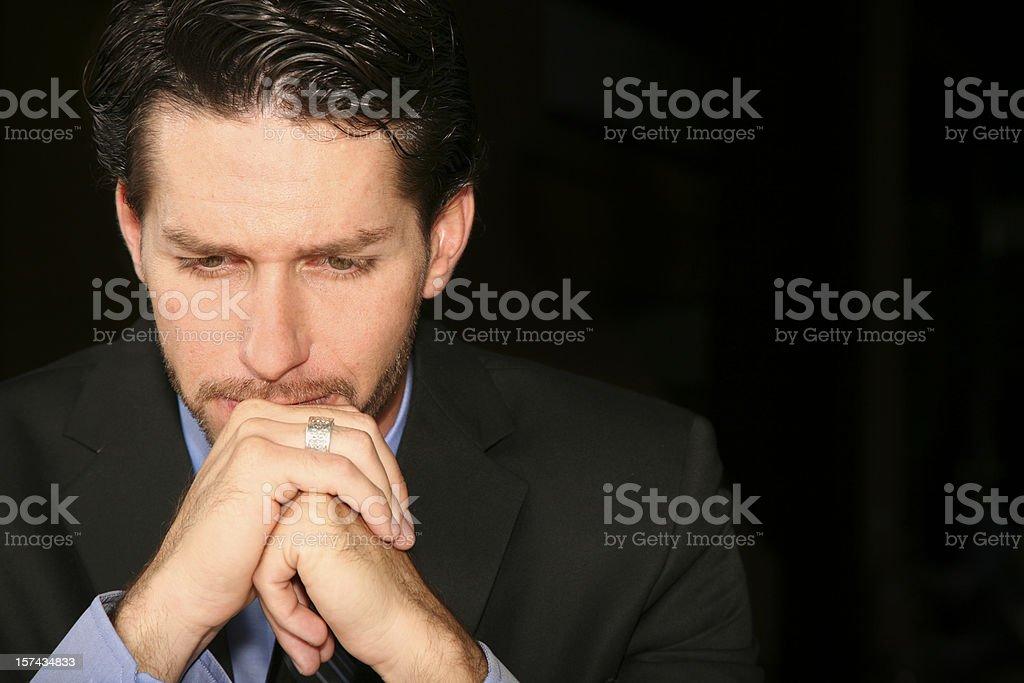 Well Dressed Caucasian Man Alone Thinking or Praying stock photo