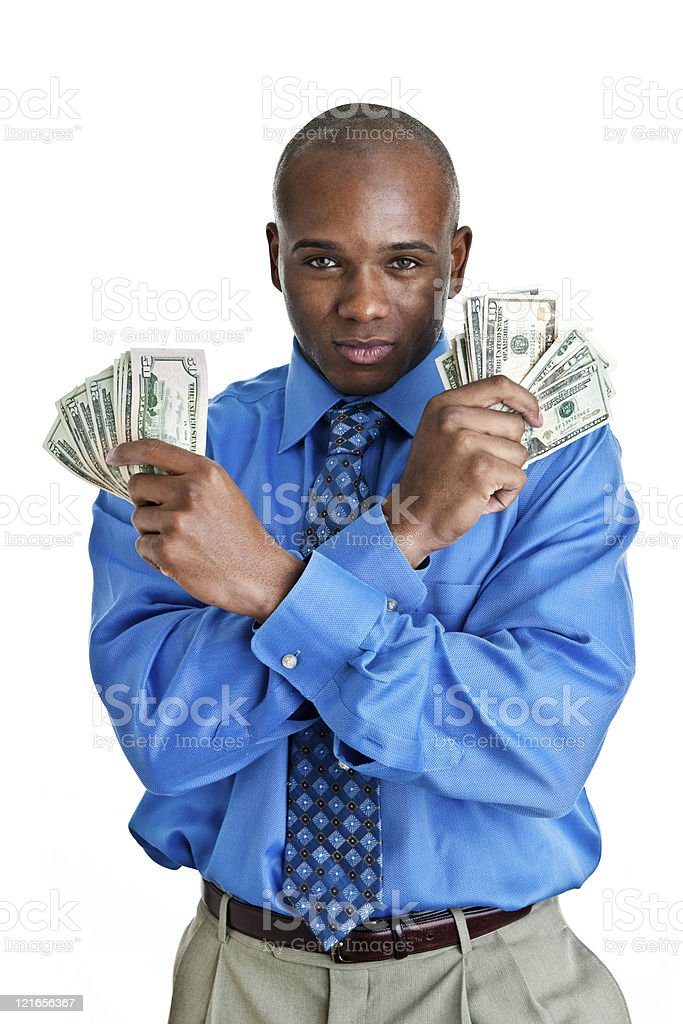 Well dressed man holding money with a serious look royalty-free stock photo