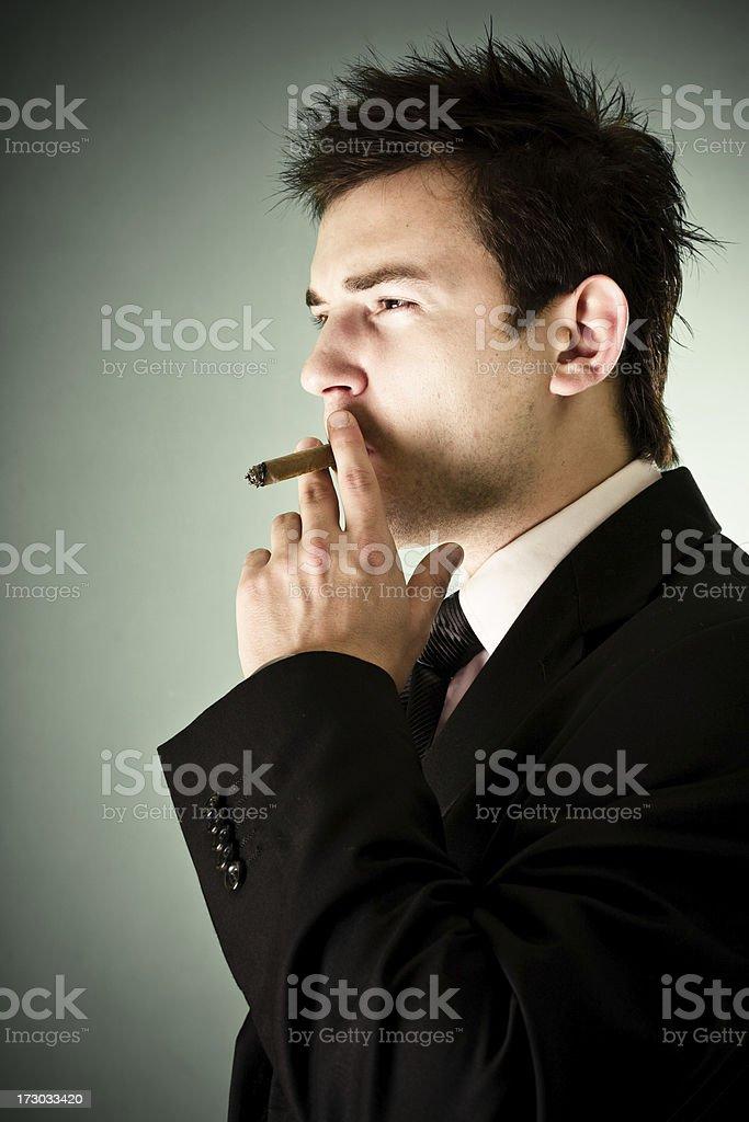 Well dressed man smoking cigar royalty-free stock photo