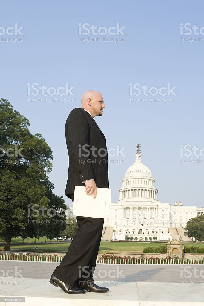 "Well Dressed Man (Congressional Staff?) Walking with Folder Marked ""SECRET"" stock photo"