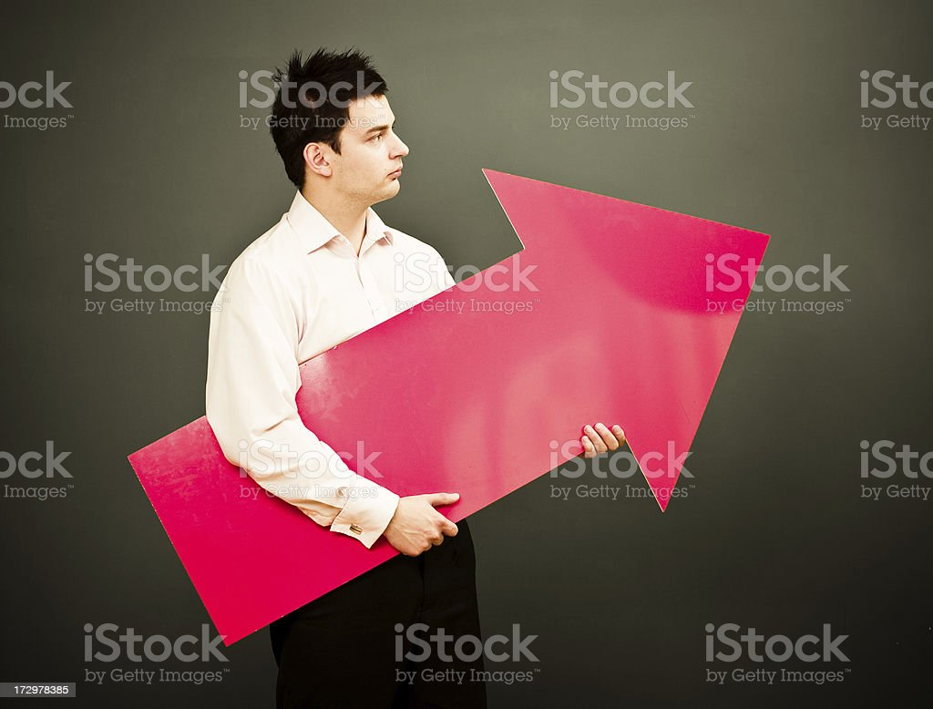 Well dressed man with big red arrow royalty-free stock photo