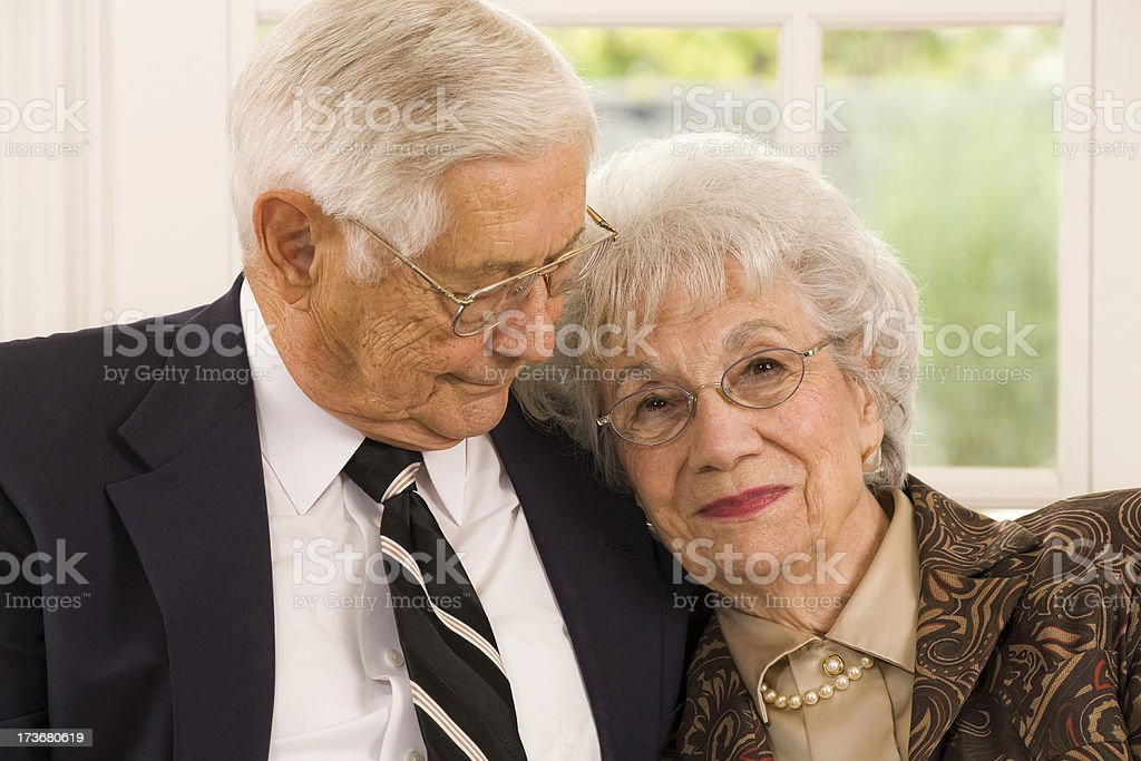 well dressed married senior couple stock photo