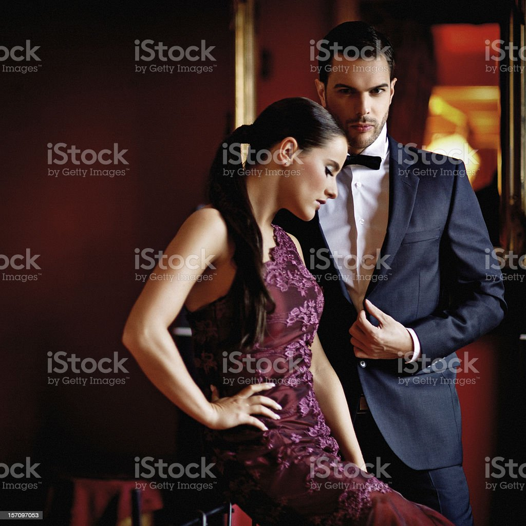 well dressed sensual couple posing indoors stock photo