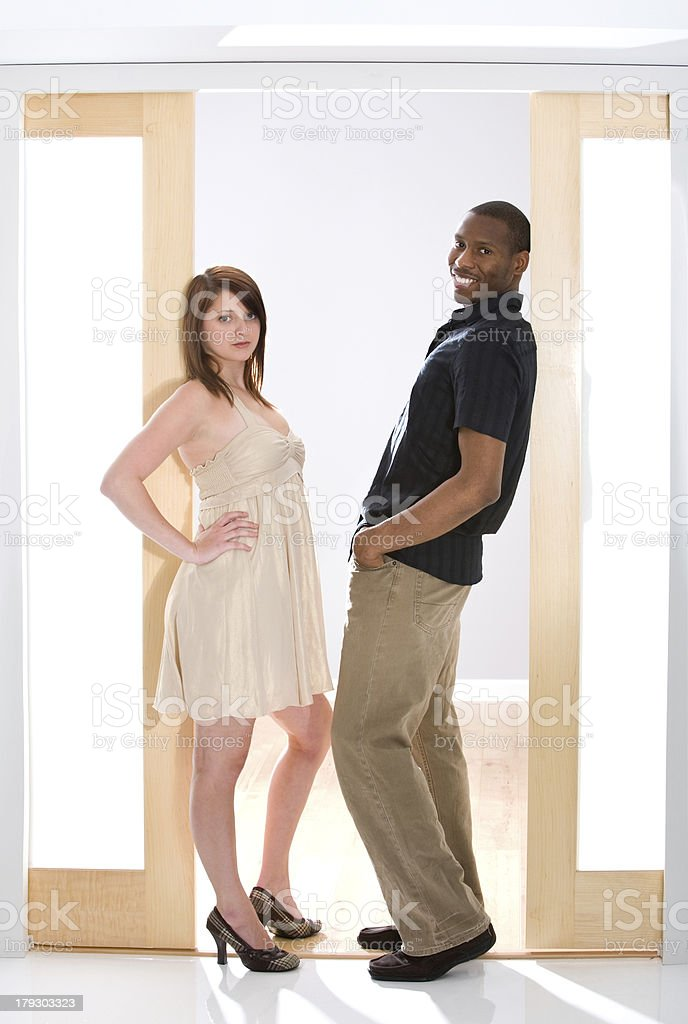 Well Dressed Young Man and Woman in Commercial Setting royalty-free stock photo