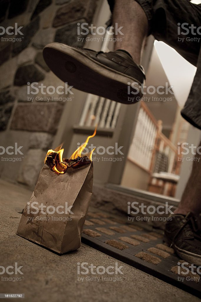 Well Known Flaming poop in bag prank stock photo