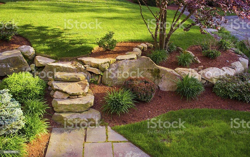 Well landscaped rock stairs and rock wall stock photo
