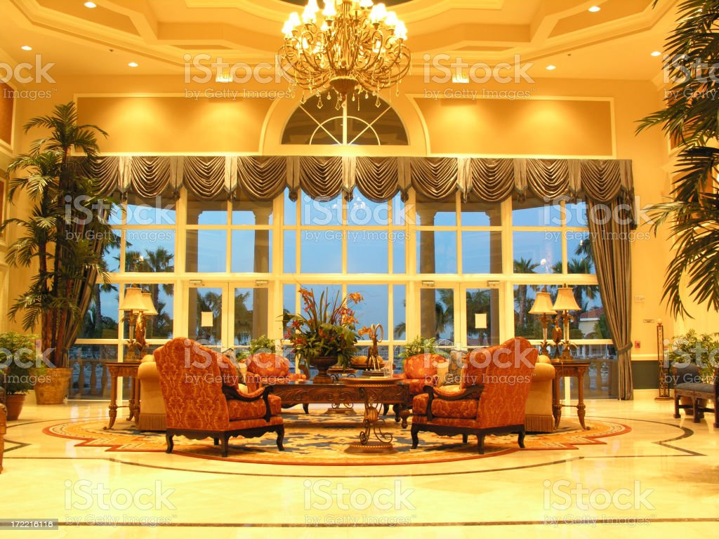 Well lit hotel lobby with nice furniture royalty-free stock photo