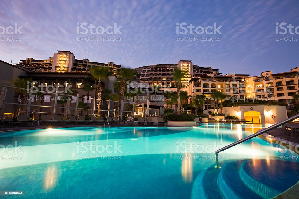 Well lit pool at Cabo San Lucas resort in Mexico royalty-free stock photo