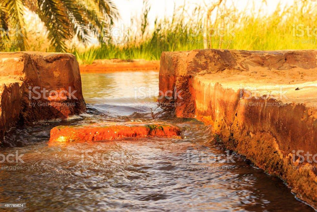 well of water moving into tunnel with grass stock photo