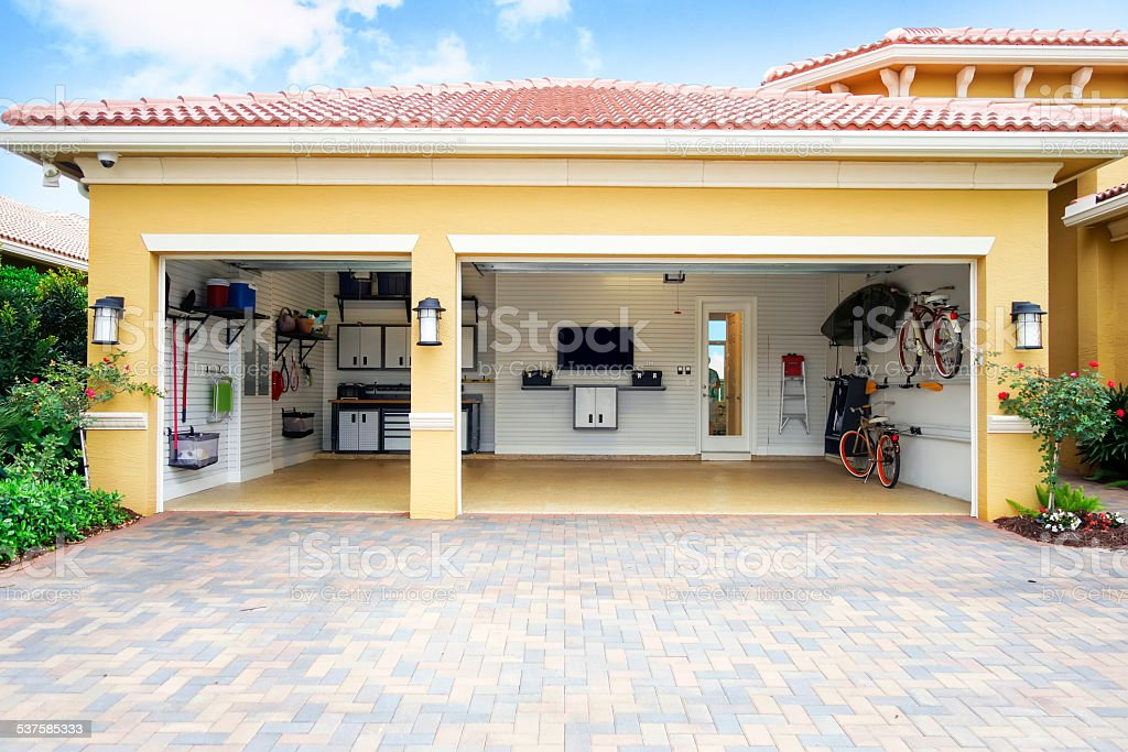 Well organized clean three car residential garage stock photo