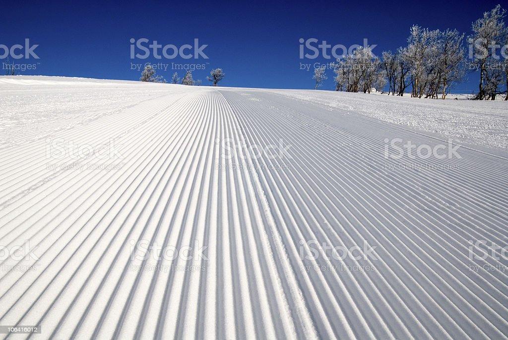 Well prepared ski piste stock photo