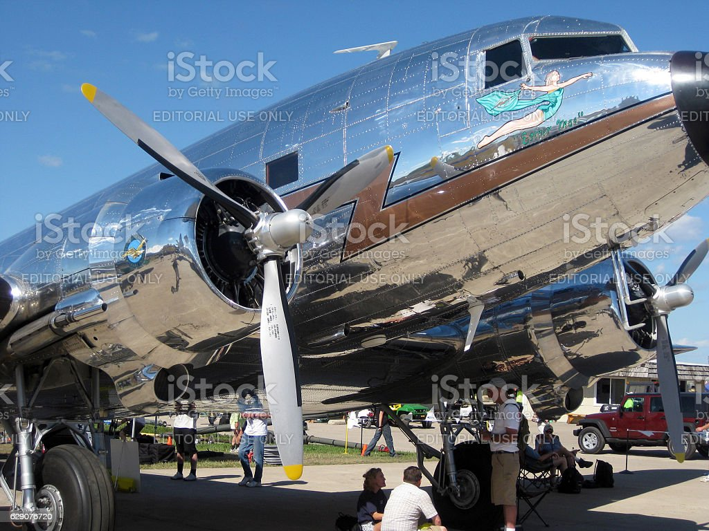 Well preserved Douglas DC-3 airplane and visitors stock photo
