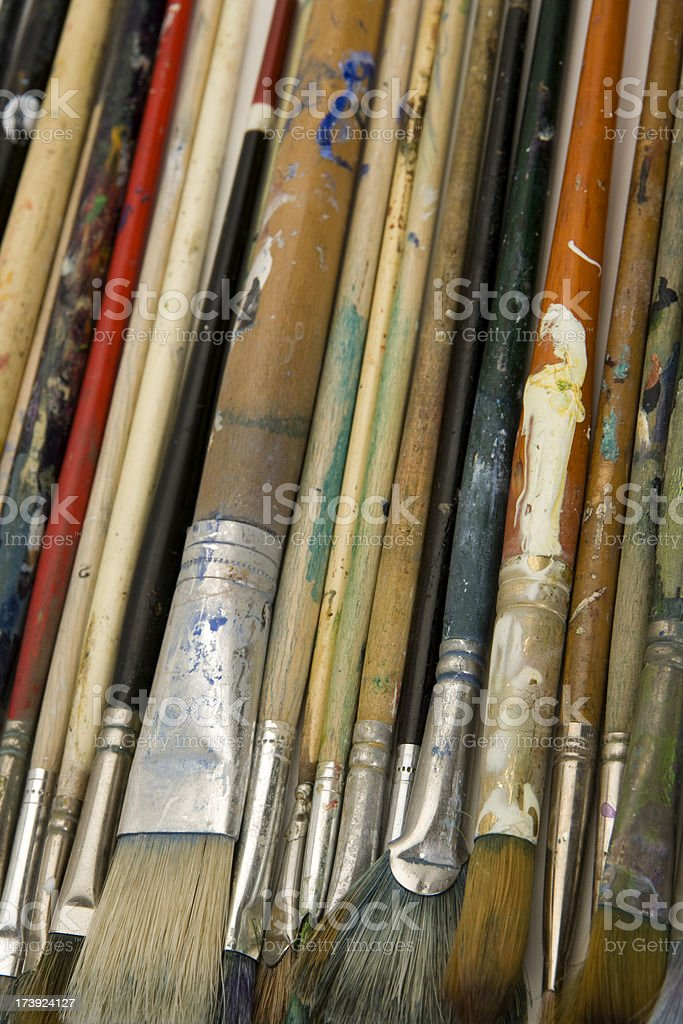 Well used artists oil painting brushes close-up background royalty-free stock photo