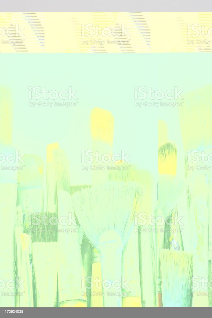 Well used artists paintbrushes on white paper with copy space royalty-free stock photo