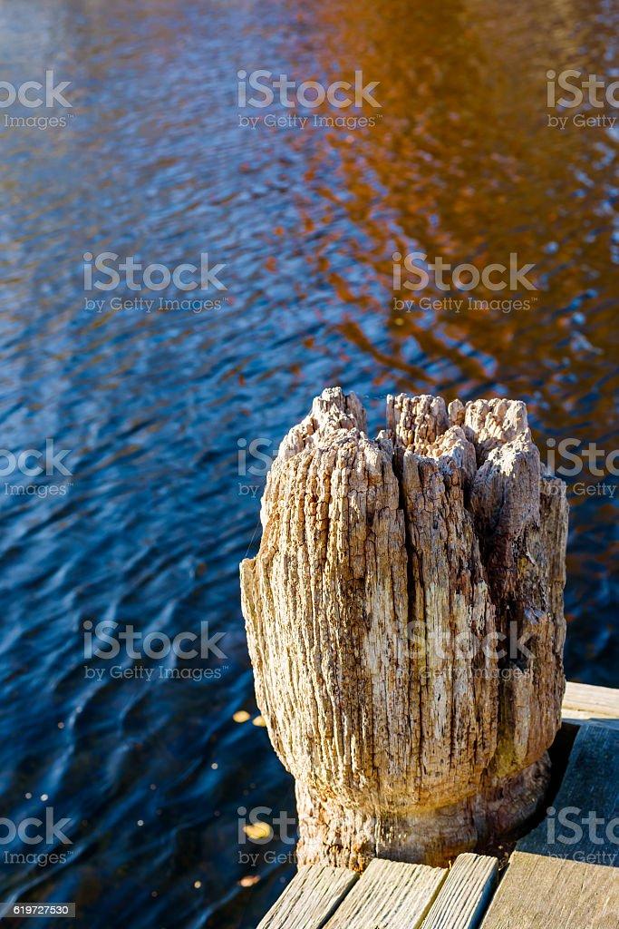 Well used mooring pole stock photo