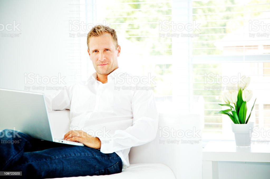 Wellbeing man using a laptop royalty-free stock photo