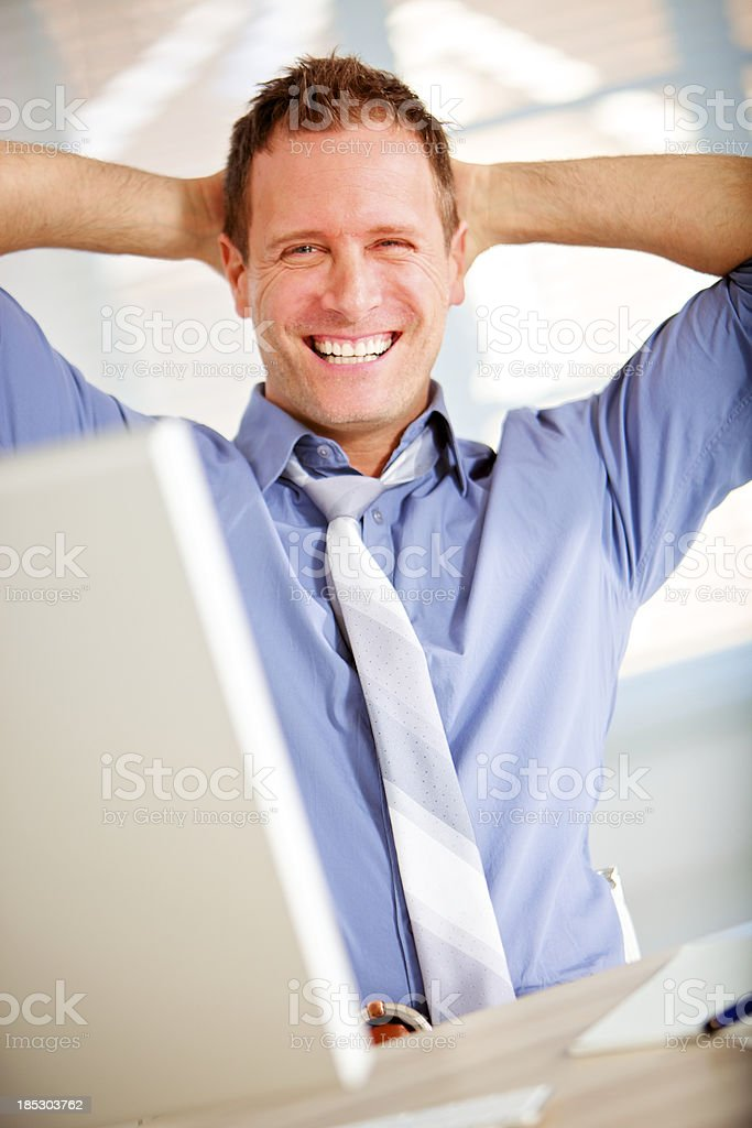 wellbeing office worker hands behind head royalty-free stock photo