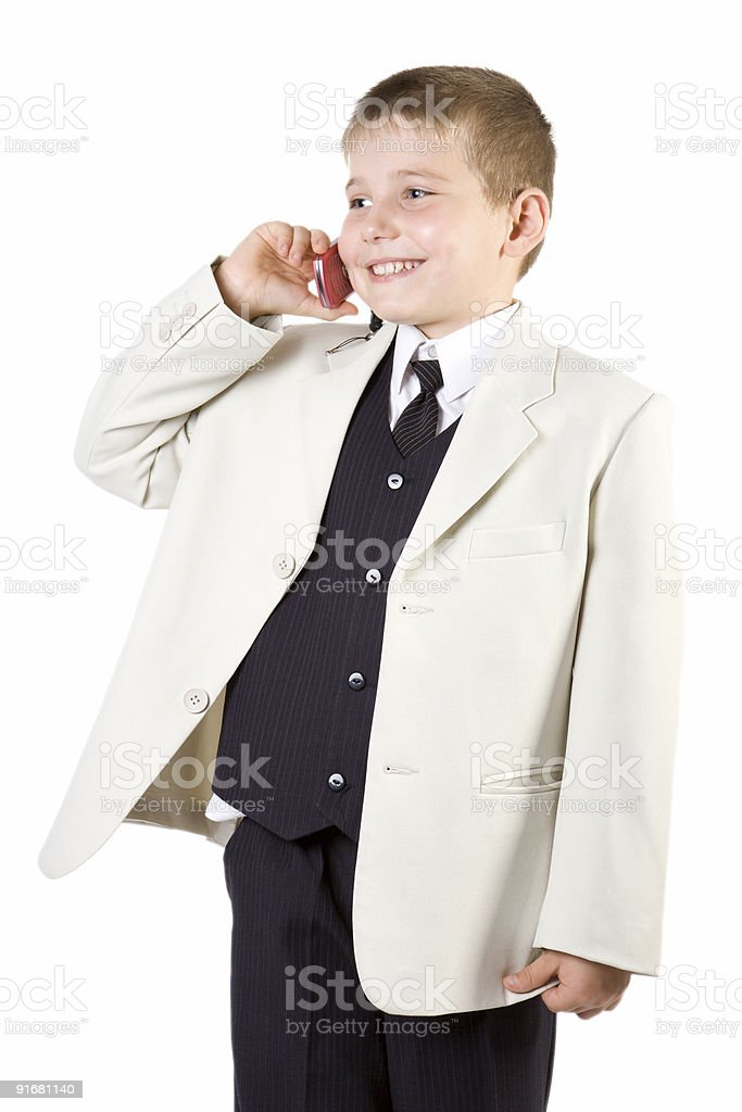 Well-dressed boy like businessman calling at phone stock photo