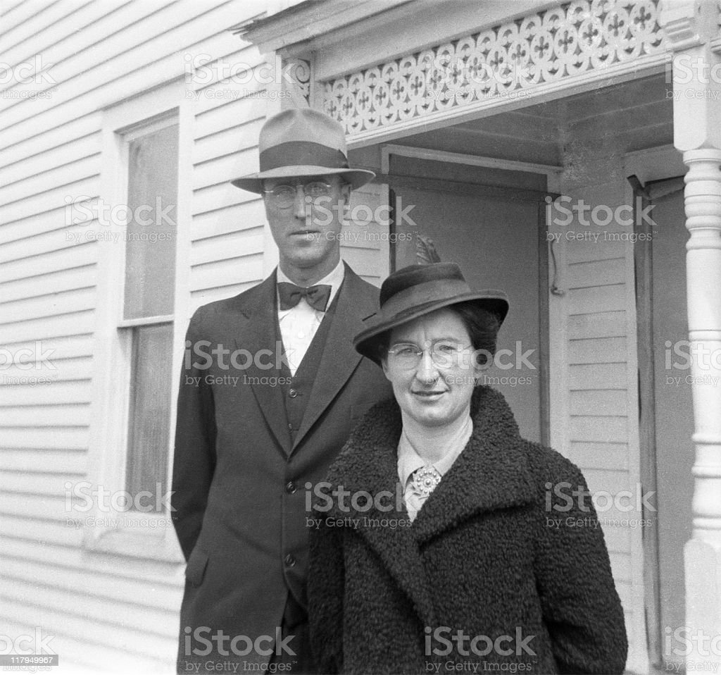 well-dressed couple in coats and hats 1941, retro stock photo