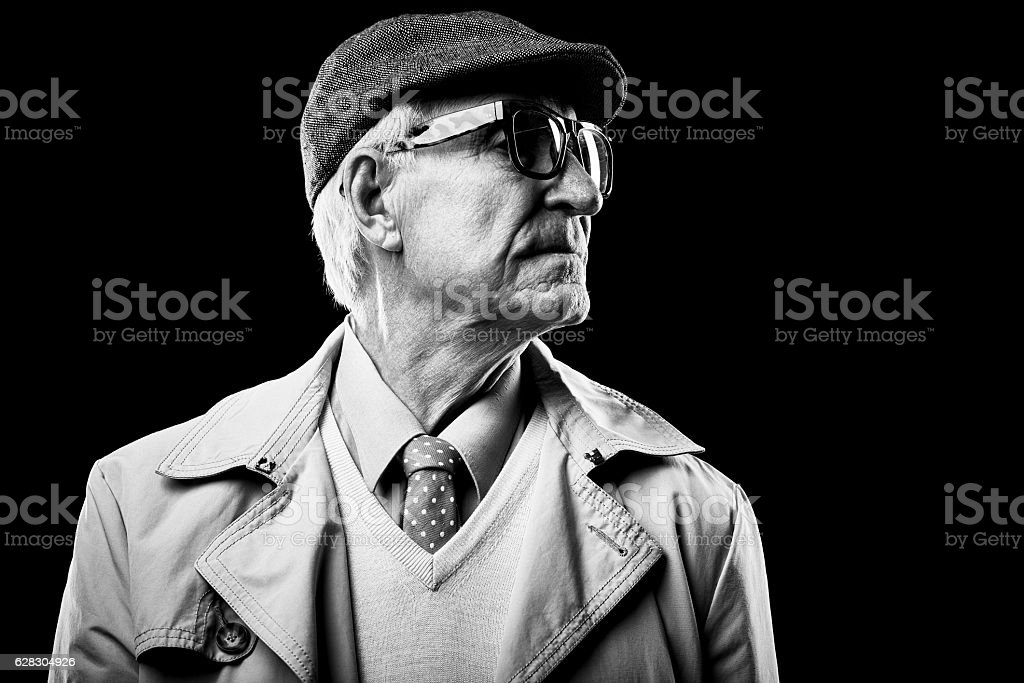 Well-dressed senior with turned head stock photo