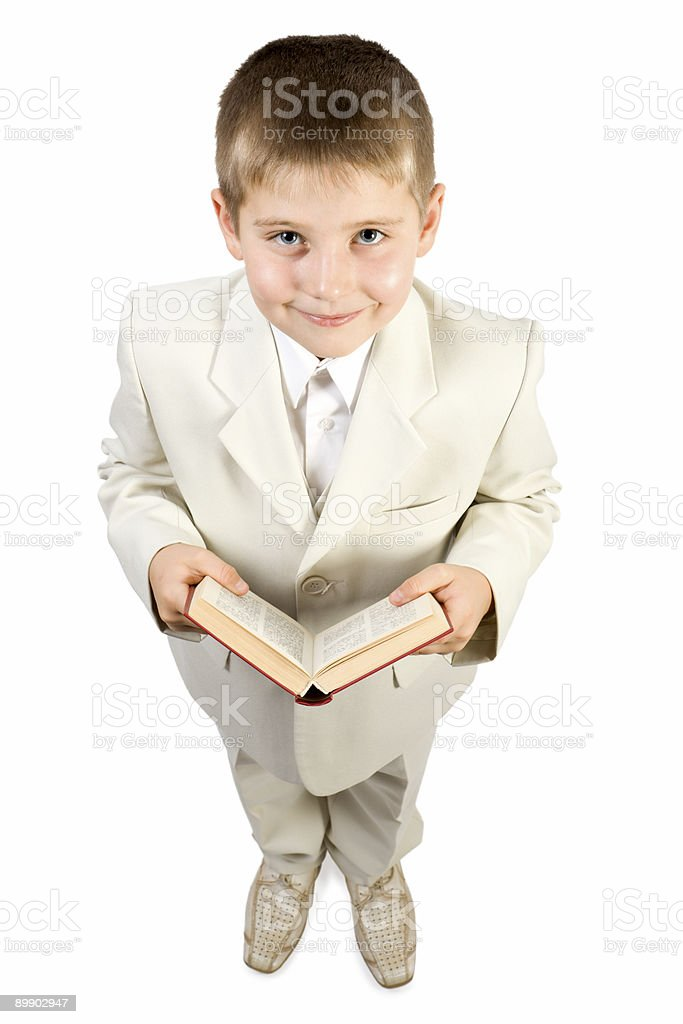 Well-dressed smiling boy hold book stock photo