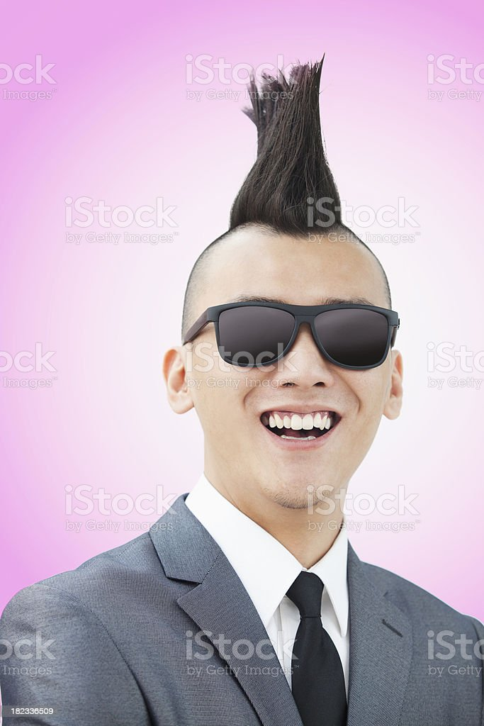Well-dressed young man with Mohawk and sunglasses royalty-free stock photo