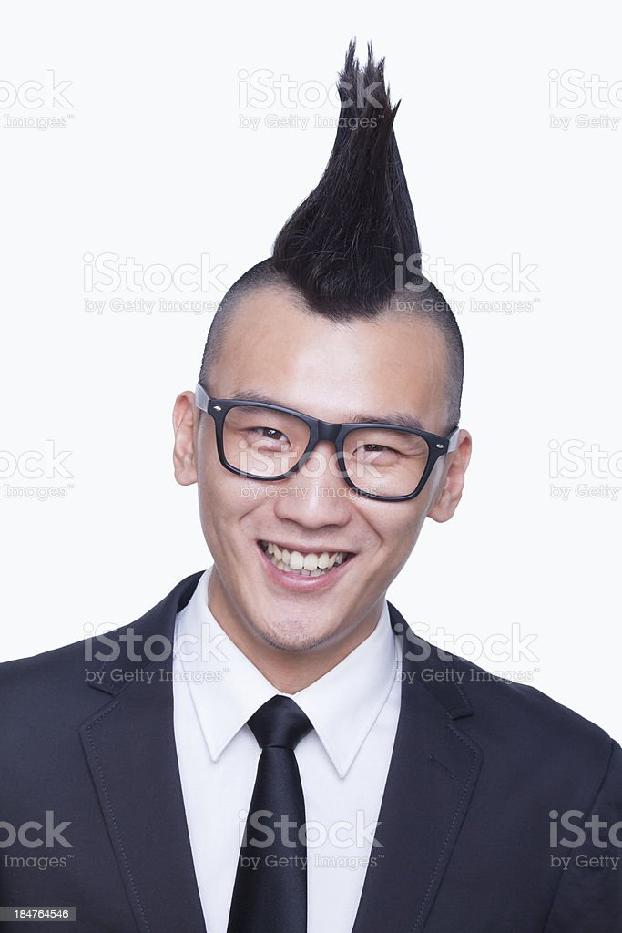 Well-dressed young man with Mohawk portrait stock photo