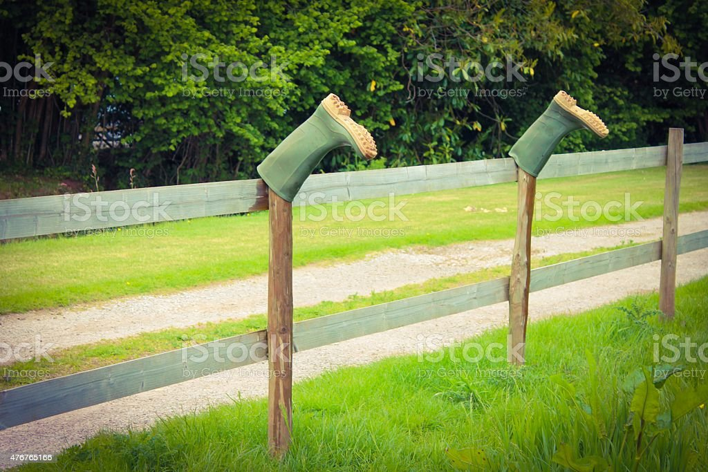 Wellies on a fence stock photo