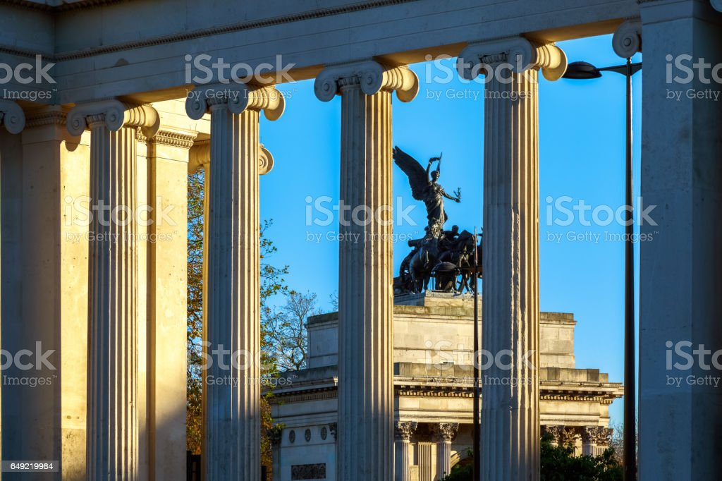Wellington Arch seen through the columns of Hyde Park Corner stock photo
