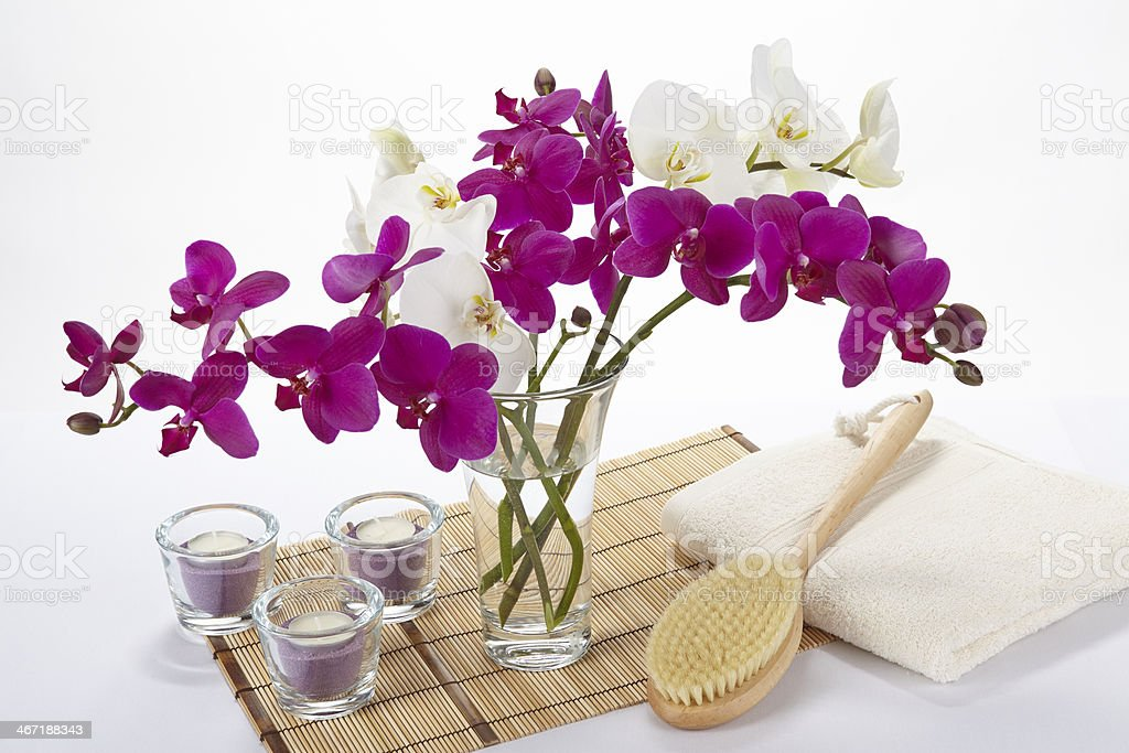 Wellness - Bath brush, towel, orchids and tealights stock photo