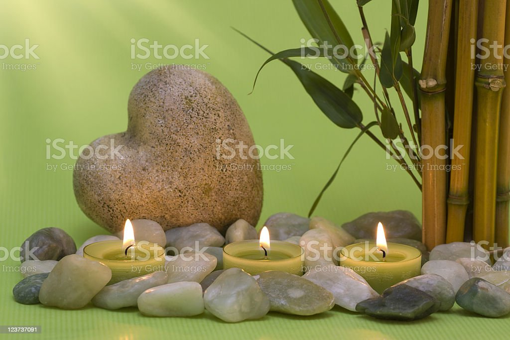 Wellness candles and a heart stock photo