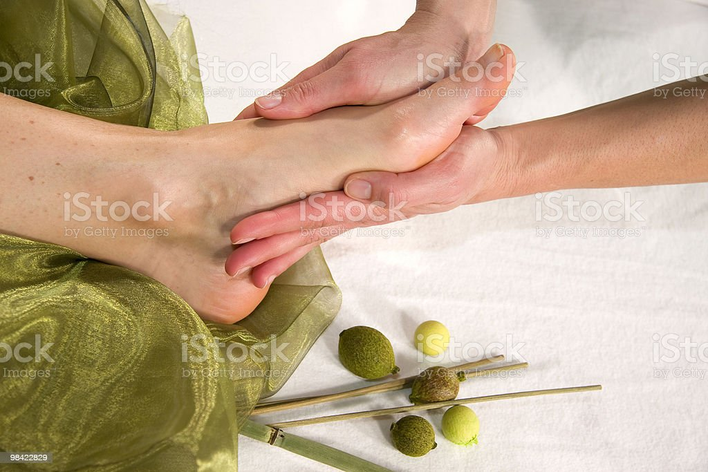 wellness composition - foot massage stock photo