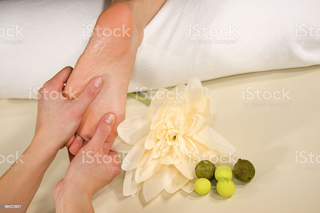 wellness composition - foot reflex zone massage royalty-free stock photo