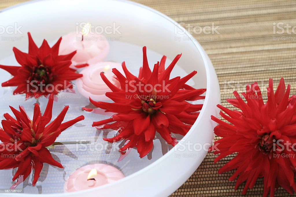 Wellness flower and candle arrangement royalty-free stock photo